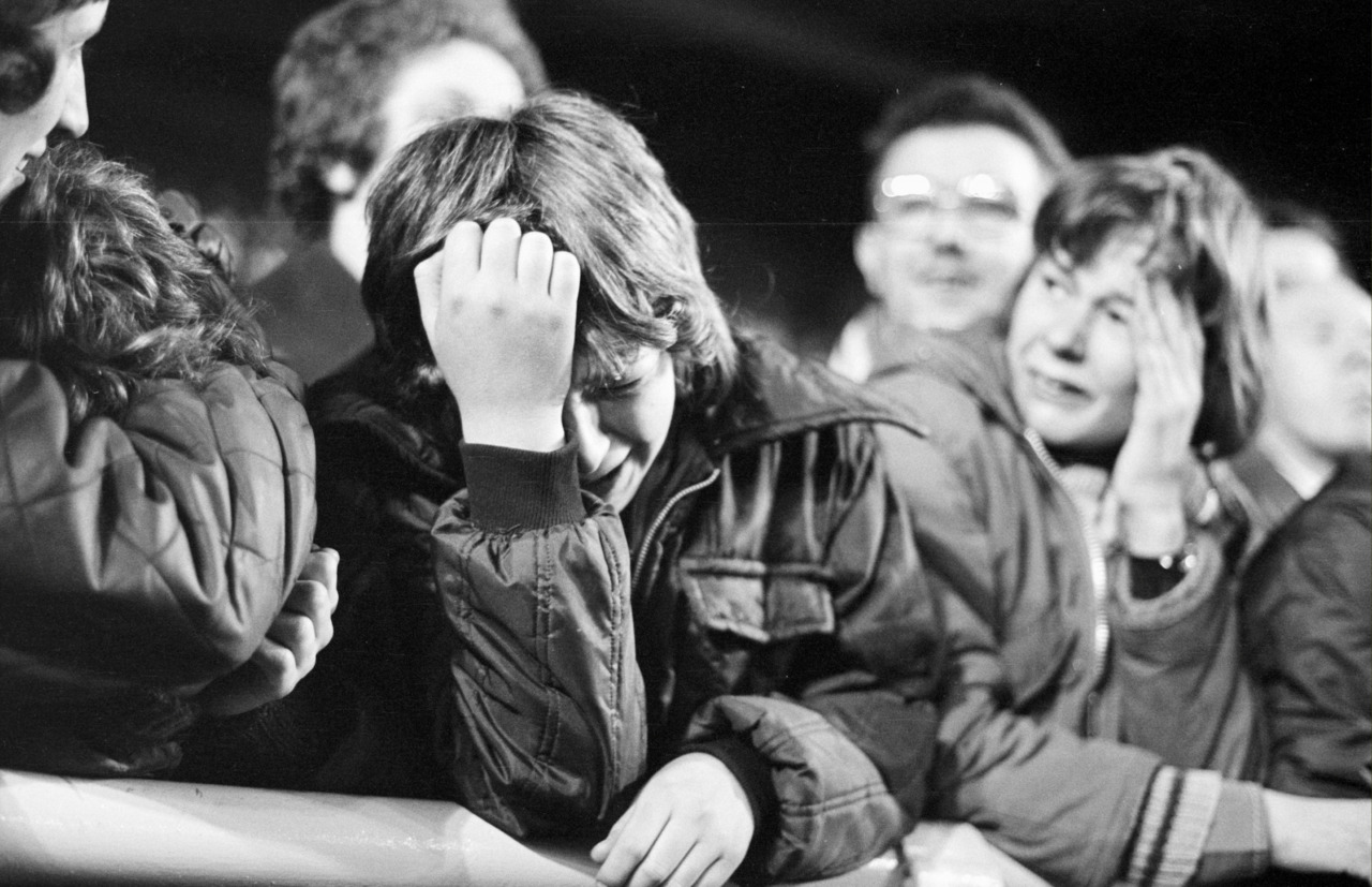 LIVERPOOL. ENGLAND. 24.10.1973 European cup 2nd round 1st leg v Red Star Belgrade (Cervena Zvezda). Young Liverpool supporter can hardly bear to watch her side concede another goal from Red Star Belgrade. The Reds let in two away goals that were to prove decisive in the away leg that ended in a 4-2 agg win for the Yugoslavian team.. and the young lad's despair proved t be correct. (Photo; Steve Hale 24th October 1973)